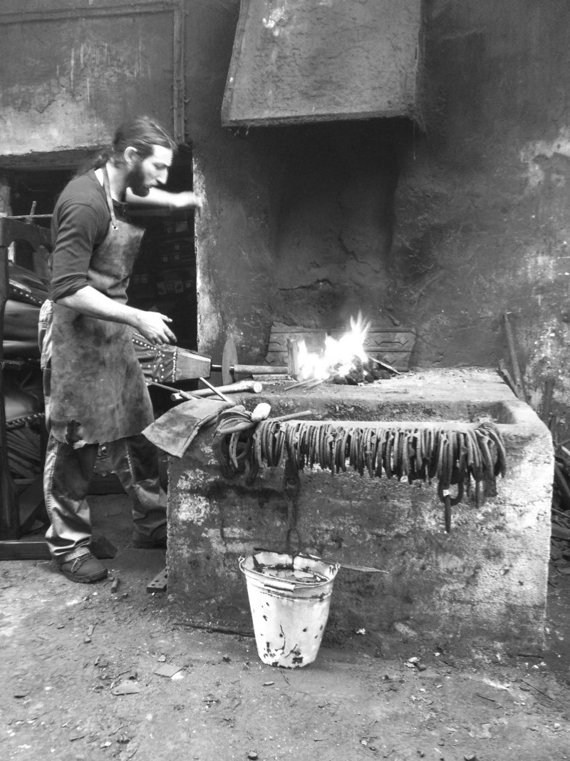 Swordsmith demonstrating forging techniques